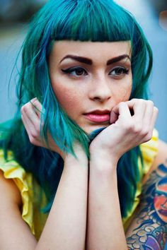 She's rocking the short fringe, and the Blue / Teal hair!