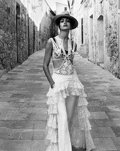 The model poses for Yelena Yemchuk in Spanish inspired fashion looks