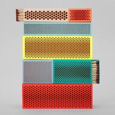 Brightly coloured matchboxes for Hay by Shane Schneck and Clara von Zweigbergk decorated with red phosphorus ink patterns.