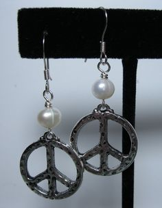 Freshwater pearl & peace sign earrings.