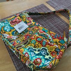 Vera Bradley bag 2 pockets on the out side.  1 large zip pockets and 2 slip compartments inside.   Beautiful color combinations of mustard yellow, red, green and teal blue. Shoulder/ mid size bag. Vera Bradley Bags Shoulder Bags