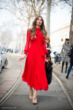 Lady in red outside Gucci. Red is popping up all over. She looks mad cool stunning yo. #MFW