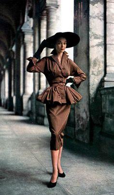 1950 Jean Patchett in bronze rayon suit with peplum jacket by unidentified designer, Harper's Bazaar,