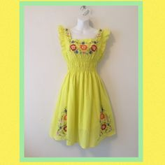 """Host PickCool and fresh lemon yellow sundress. Perfect summer slip on peasant-style dress with ruffled bodice and beautifully colored embroidery. Fully lined, 100% cotton, excellent condition. Flattering and comfy 4"""" elastic empire waist. Tag says XL but could easily fit a Med or Large based on design and measurementsLength is 36"""" from shoulder to hem and appx 21"""" from waist to hem Bust area is 19"""" armpit to armpit Waist area unstretched is 26"""" Just Love Dresses"""
