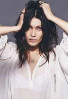 Bella Hadid turns up the heat in spring's best denim looks. See the full rock 'n' roll Victoriana shoot.
