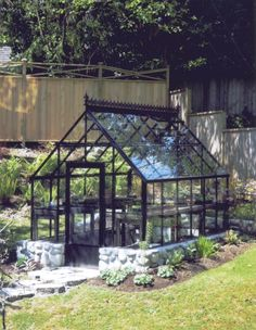 The Cape Cod Greenhouse, smaller size, custom painted black. - http://garden-greenhouse.se
