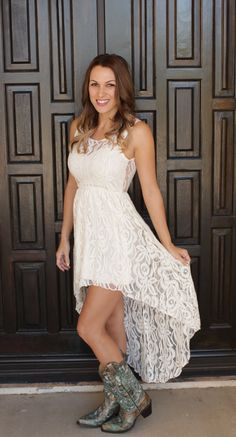 """Cream colored Beautiful Sweetheart Swing Dress in Sheer Rosette Lace with High Low Hemline and Deep V Back.  -80% Cotton, 20% Nylon.  Model is 5'6"""" and wearing a small."""