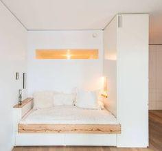 Schlafnische mit Fenster von Holzgeschichten