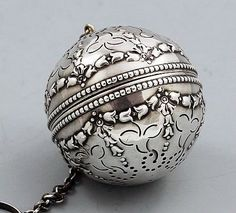 A Gorham sterling embossed tea ball pierced and decorated with embossed swags. Circa 1900.