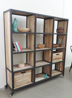Solid recycled timber bookcase with metal trim on lockable castors. Measures 1700mm (h) x 380mm (d) x 1620mm (w)