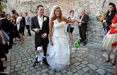 Slovakian Alpine ski athlete Veronika Velez- Zuzulova (R) and her husband and condition coach in her team Romain Velez of France pose with their marionettes after their church wedding ceremony at the St. Martin's Cathedral in Bratislava, on April Church Wedding Ceremony, Alpine Skiing, April 27, Bratislava, Bridesmaid Dresses, Wedding Dresses, The St, Cathedral, Athlete