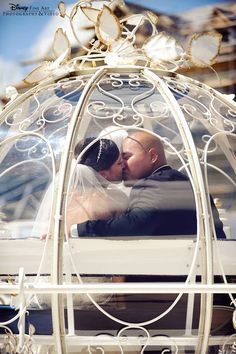 Disney World fairy tale wedding. Cinderella's horse drawn carriage ride. How romantic!