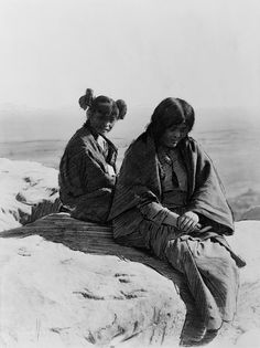 Edward S. Curtis: Maiden and matron, 1905 Maiden and Matron. Drawing on photograph shows two Hopi females sitting on a rock, by Edward Sheriff Curtis, 1905