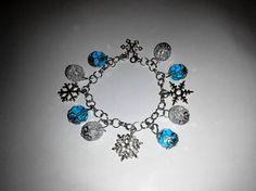 Winter bracelet Snowflake Charm Bracelet Love Snow Gift Winter http://www.allthingsvogue.com/best-affordable-silver-bangle-bracelets/