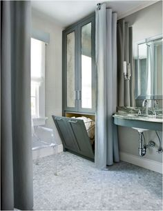 mirrored gray cabinet with hamper