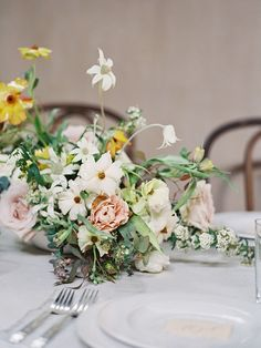 Organically composed centerpiece with the unexpected addition of yellow.   #weddingflowers