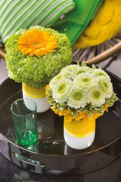 Two small gerberas bouquets in white vases #orangegerberas #yellowgerberas #inspiration #colouredbygerbera #dutchgerbera
