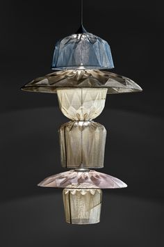 We have taken the best of our Ukhamba lamps and combined them to create our Totem Chandelier masterpiece. Each handmade Chandelier is available in a range of glimmering metallic colours.