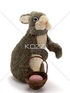 easter bunny with basket - An Easter decoration of a bunny and a basket on a white background.