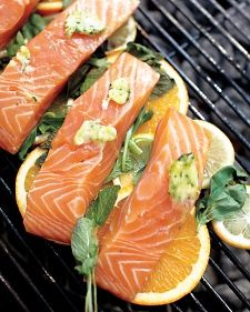 Grilled Fish with Citrus & Orange-Herb Butter, recipe from Martha Stewart: A layer of citrus slices between the fish and the grill means theres no chance of sticking, and the fish gets infused with flavor. Citrus Recipes, Salmon Recipes, Fish Recipes, Seafood Recipes, Tilapia Recipes, Orange Recipes, Summer Recipes, I Love Food, Good Food