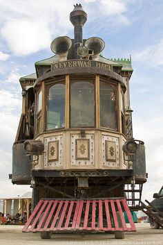 The Neverwas Haul; Burning Man 2006 & 2007 (Photo by Daniel Winningham / dwinning's photostream, Flickr).  Steam-propelled 3-storey Victorian house with Camera Obscuro installed in the turret.  Built by Members of the Academy of Unnatural Sciences, based in UC Berekeley.  See more info at The Neverwas Haul website (http://neverwashaul.com/).