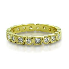 @ila: Princess and Rounds in Bezels  An eternity of 0.53ct of princess cut and round cut diamonds all bezel set in 18K recycled gold with millgraining accents. #bridal