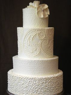 This may be the first wedding cake that my jaw dropped at. (Yes, all wedding stuff is either under PARTY or STYLE until I get engaged... they may be there for a while)
