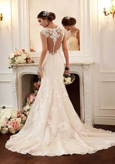 Glamorous and extravagant, get ready to fall in love with this vintage-inspired wedding dress from the Stella York bridal gown collection. The lace shoulder straps and sweetheart neckline perfectly frame the face, while the lace racer-back detailing will make every exit as beautiful as your entrance. The hem and dramatic train feature scalloped lace. The back zips up under fabric-covered buttons.
