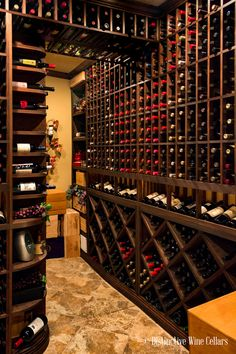 Wine on nearly every side! There are so many options when it comes to designing your wine room. Let us help you create a Custom Wine Cellar designed to match your wine and lifestyle. | Ultimate Closet Systems | Wine | Wine Bottles | Wine Cellar | Wine Room | Wine Collection | Wine Cellar Design | Wine Cellar Closet | Wine Cellar Basement