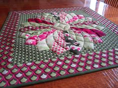 Love how the quilting makes this look like a dahlia.Dresden Plate with curved quilting, very clever.