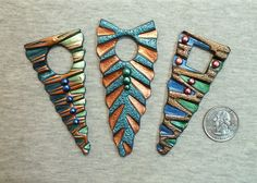 Dagger style pendants created in polymer clay Elsie Smith