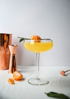 Mandarin Gin Fizz Cocktail A Gin Fizz Cocktail made with seasonal fresh Mandarins. A perfect way to keep cocktail hour fresh over the winter months! Recipe adapted from The New Cocktail Hour Gin Fizz Cocktail, Gin Cocktail Recipes, Easy Cocktails, Summer Cocktails, Cocktail Shaker, Craft Cocktails, Cocktail Movie, Cocktail Sauce, Drink Recipes