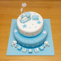blue baby shower or first birthday cake train