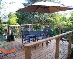 Garde corps inox et bois pour terrasse.