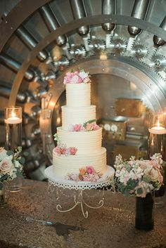 Simple yet beautiful wedding cake with pink floral accents.  Coordinator: Andrea Famiglietti, Coastal Celebrations, Baker: Sweet by Holly, Photographer: Brooke Images