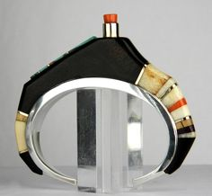 Cuff | Charles Loloma.  Ironwood, Turquoise, Coral, Fossilized ivory, Gold & Silver.  ca. 1980