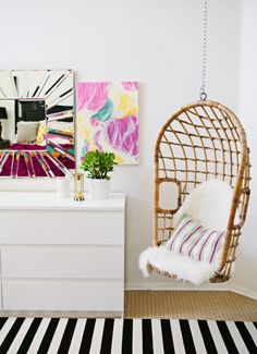 I wanted to make the master bedroom light and bright. I believe that I was able to achieve this look by using a white base on my walls and incorporating bright and happy pops of color. My favorite furnishing in the room is the swinging egg chair which I found on Craigslist, Capri hops on and swings delightfully. Smiles and laughter are a direct result from this chair.