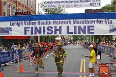 Jeff LeCompte, a retired fire fighter from Bethlehem, PA Local 735 sent us this photo of him and Bethlemen fire fighter Bob Simons as they crossed the finish line of the Lehigh Valley half-marathon with air cylinders on their back as a tribute to the 343 FDNY fire fighters lost on 9/11.