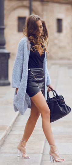Kenza Zouiten is wearing a light blue fluffy cardigan from Weekday, skirt and top from IvyRevel, transparent shoes from Jennie-Ellen and the bag is from Balenciaga