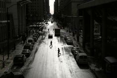 The mid-day sun reflects off Clark Street, wet from newly melted snow, looking south from Lake Street.