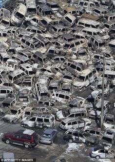 In this photo taken Friday, March an aerial view shows vehicles washed away by an earthquake triggered tsunami in Hitachinaka, Ibaraki prefecture, Japan. The country's biggest recorded earthquake slammed into its eastern coast Friday. Japan Earthquake, Earthquake And Tsunami, Earthquake Damage, Tornados, Natural Phenomena, Natural Disasters, Mother Earth, Mother Nature, Apocalypse