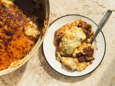 From Saveur-This traditional Greek casserole featuring spiced ground lamb and eggplant is based on a version served at Greek restaurant Molyvos in New York City.