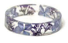 Real purple flowers made into a bracelet
