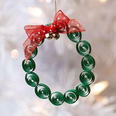 Create your own mini wreath using strips of paper, ribbon, jingle bells and thread. Find more ornaments that kids can make: www.bhg.com/christmas/ornaments/easy-ornaments-kids-can-make/?socsrc=bhgpin100912quilledwreath#page=22