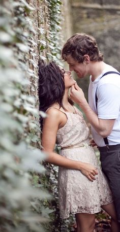 His hand on her chin...SO romantic. I'm stealing this pose.