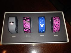 Disney Magic Band decorating  Used black sharpie, dipped a toothpick into puffy paint, and hot glued rhinestones