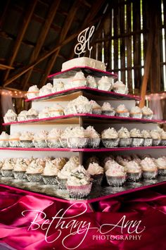 This cupcake-wedding cake is to die for! I don't think I would mind having a cupcake-wedding cake if it looked like this!!