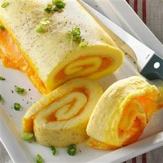 Baked Omelet Roll Recipe -This recipe is a deliciously different way to serve an omelet. The eggs bake in the oven, so you don't have to keep a constant eye on them like omelets made in a frying pan on the stove.—Susan Hudon, Fort Wayne, Indiana