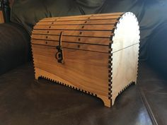 """After building a rustic chest by hand from pine for one of my children, I thought it would be fun to design and build others via laser cutter. It turned out more beautiful than I anticipated, especially after organizing the cuts for a grain matched look. The design assumes 5mm plywood (1/4"""" plywood). Extra small parts are cut in case a piece breaks or the piece finds a resin pocket in the plywood. The 2D diagram layout assumes a 0.2mm laser kerf."""