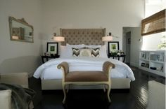 Beautiful master bedroom with tan accents